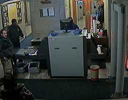 Sheriff's deputies say that these Allegheny County Courthouse surveillance images show a man who wrongly claimed lost money at the metal detector.
