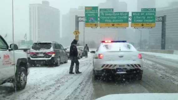 An accident scene on the inbound Fort Pitt Bridge ramp toward downtown Pittsburgh.