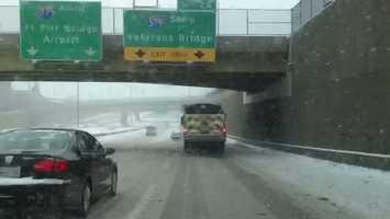 A truck spreads salt on Interstate 279 near downtown Pittsburgh.