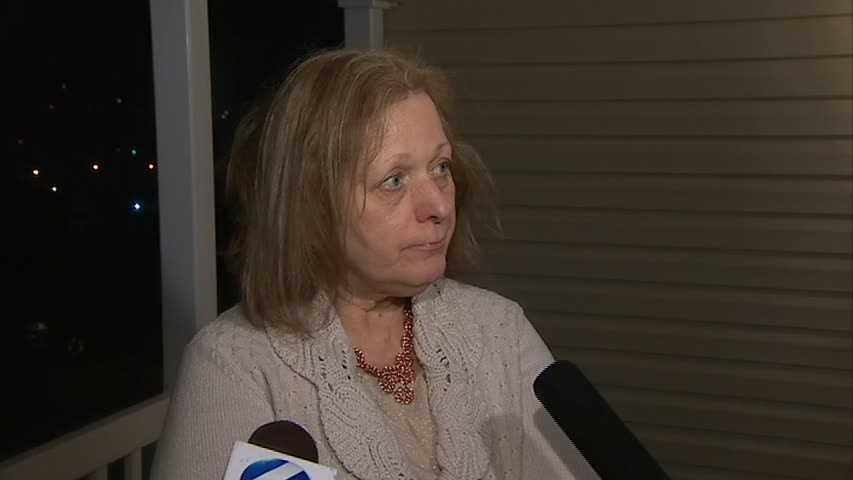 Gloria Calabro, a neighbor, said she was on her way out when she heard Crawford banging on the woman's door and asking to be let inside. Later, she came home and saw the police activity.