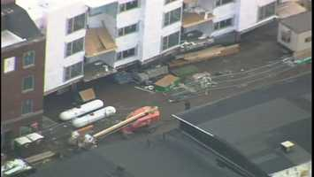 Sky 4 flew over the building at 49th and Harrison streets, where debris and construction materials were scattered on the ground.