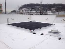 The store features a solar canopy roof that helps offset the store's need for electrical power.