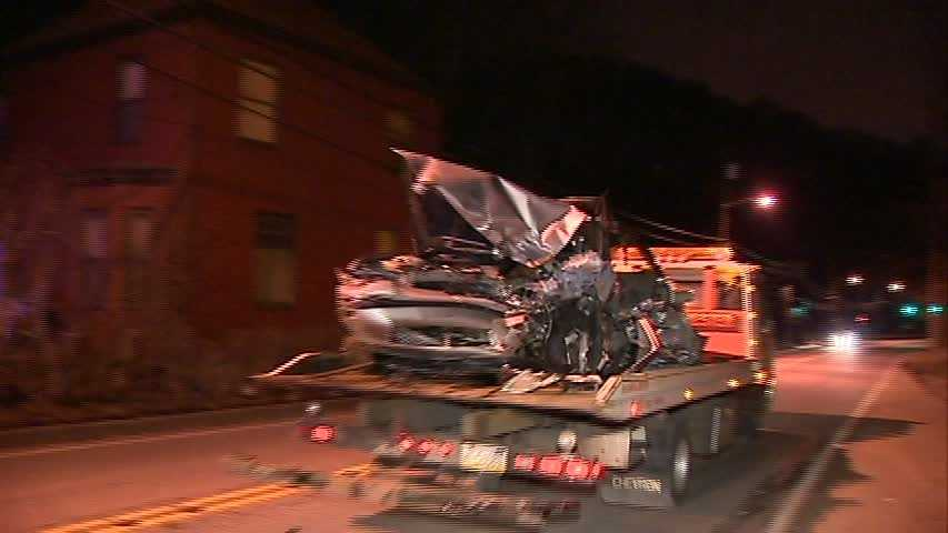 A tow truck removes one of the cars that was involved in the fatal crash on Mifflin Road in Lincoln Place.