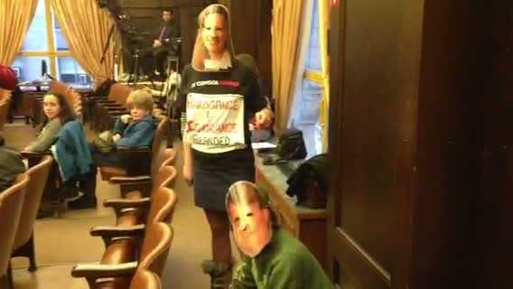 Two people wore masks, and one of them was on a leash, to express their anti-drilling views and to mock Consol Energy and the Allegheny County Council.