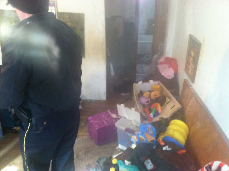 """According to police, officers had to """"forcefully push the door open"""" because dirty clothes and garbage were piled up throughout the house. The odor in the home was described by police as """"unbearable"""" and """"every room was so deplorable that you could not see the floor from the large amounts of garbage and dirty clothes scattered throughout the residence."""""""