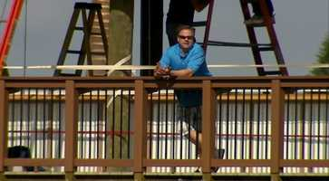 Action Sports' Guy Junker takes in the view from the new boardwalk at McKechnie Field.