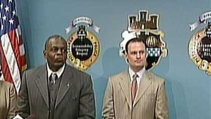 Nate Harper and Luke Ravenstahl, standing together in 2011 at a Pittsburgh Police Bureau news conference.