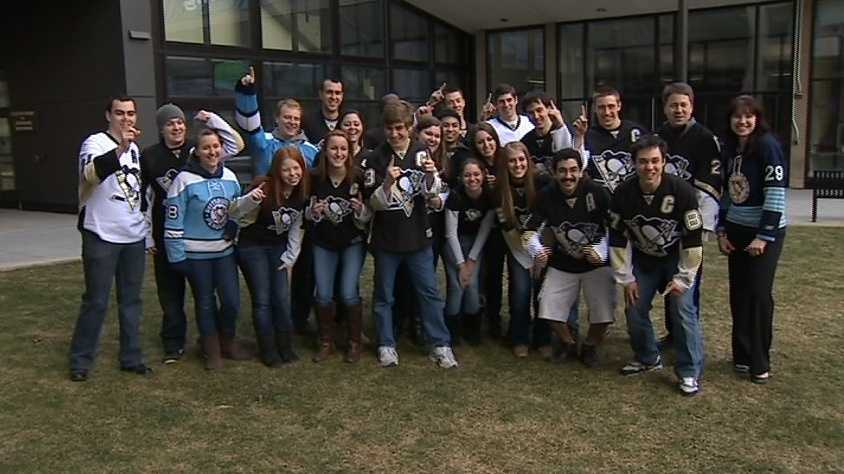All the Penguins fans pose the camera.