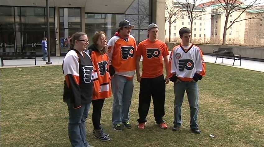 Flying Five: These students, supportive of Philadelphia, seem to be outnumbered by Penguins fans.