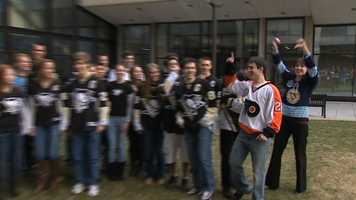A Flyers fan tries to stir up a little trouble with Penguins fans.