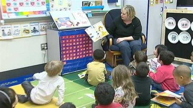 teacher reads to students