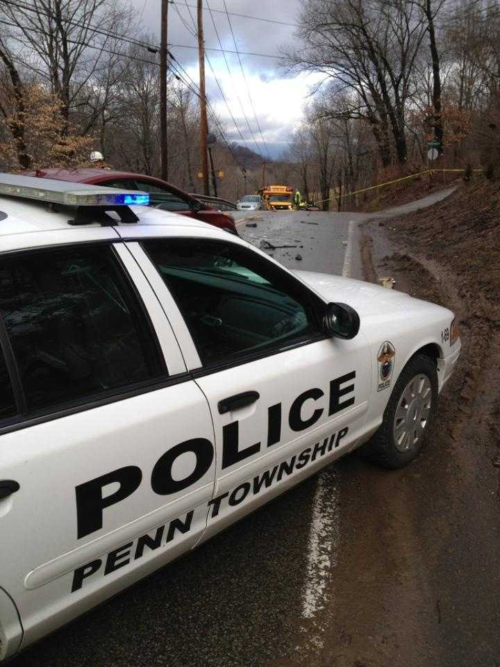 Police in Penn Township say a driver threw suspected heroin out of his car window after crashing head-on into a school bus.