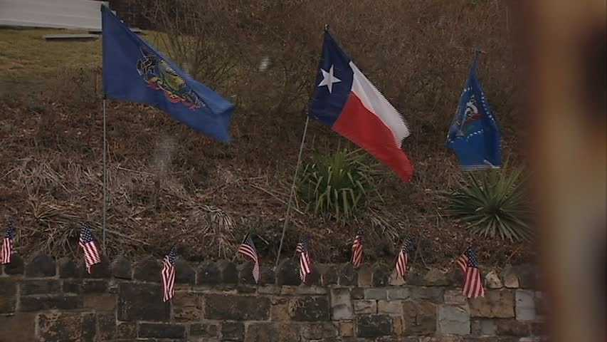 """From there, Flohr was hooked, turning his yard into something that resembles the United Nations. """"I think I have more flags than the United Nations,"""" he said."""