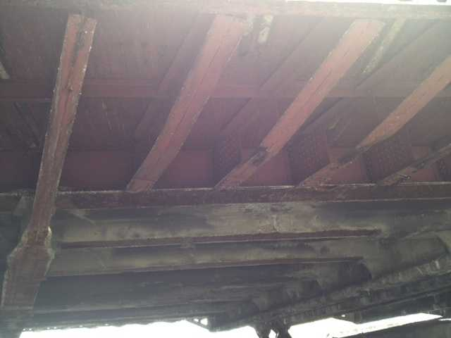 A photo of the deteriorating underside of the South Highland Avenue bridge.
