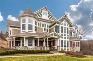 This home in Pine Township features five bedrooms, six bathrooms, and is beautifully landscaped.