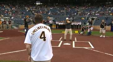 "Wearing a custom Pirates jersey with the website address ""LiveLikeLou.org"" across his back, Alexander threw out the first pitch to former Pirates pitcher and current broadcaster Steve Blass."