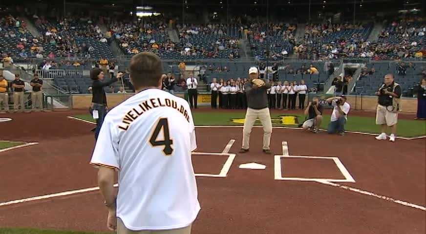 """Wearing a custom Pirates jersey with the website address """"LiveLikeLou.org"""" across his back, Alexander threw out the first pitch to former Pirates pitcher and current broadcaster Steve Blass."""