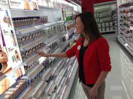 Target manager Jen Fiegle shows off the cosmetics display.