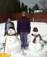 Fox and Lola with their snowmen in Indiana, Pa.