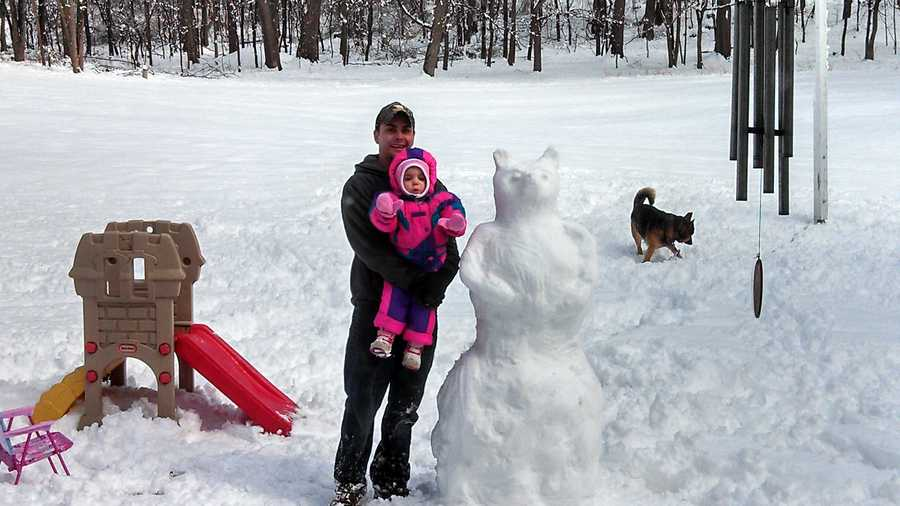 Tommy DeMase and daughter Eva built a snowbear in Saltsburg.