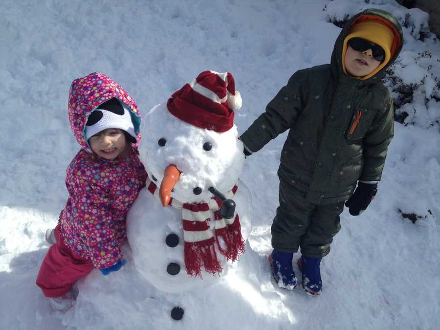 Their first snowman in Forest Hills.