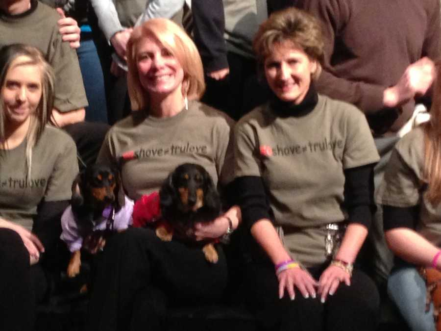 LHAS board president Laura Penrod Kronk, with her therapy dogs, Romeo and Hercules. On her right is executive director Dee Dee Troutman.