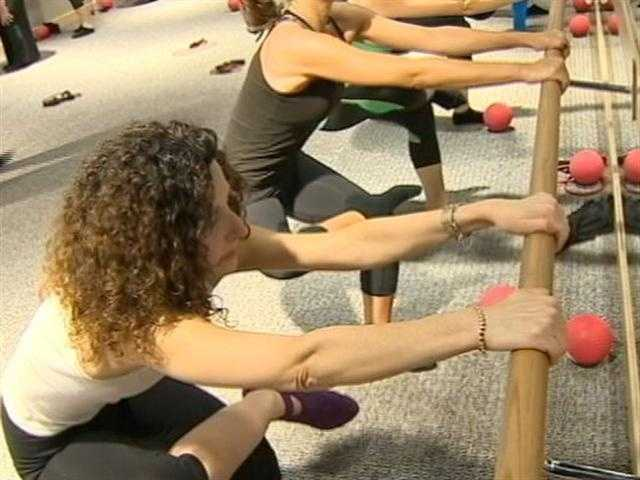 To help shed unwanted pounds, Pure Barre combines three different styles of exercise: Pilates, ballet and yoga.