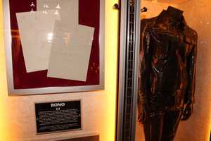 """This patent leather suit was worn by U2 front-man Bono as his stage persona """"The Fly"""" during the group's Zoo TV tour."""