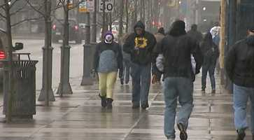 Pirates fans walked through some light snow before the home opener against the Chicago Cubs at PNC Park.