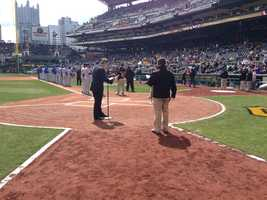 Pirates broadcaster Greg Brown announces the starting lineups