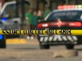 A gun battle broke out in front of shops at the Edgewood Towne Center on a sunny Saturday afternoon. Three people were shot.