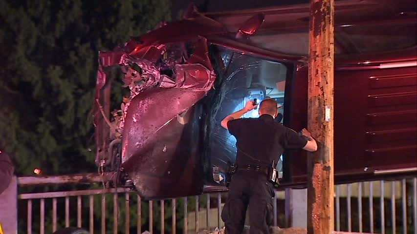 A vehicle that witnesses estimate was traveling close to 100 mph crashed and ended up teetering on the railing for hours.