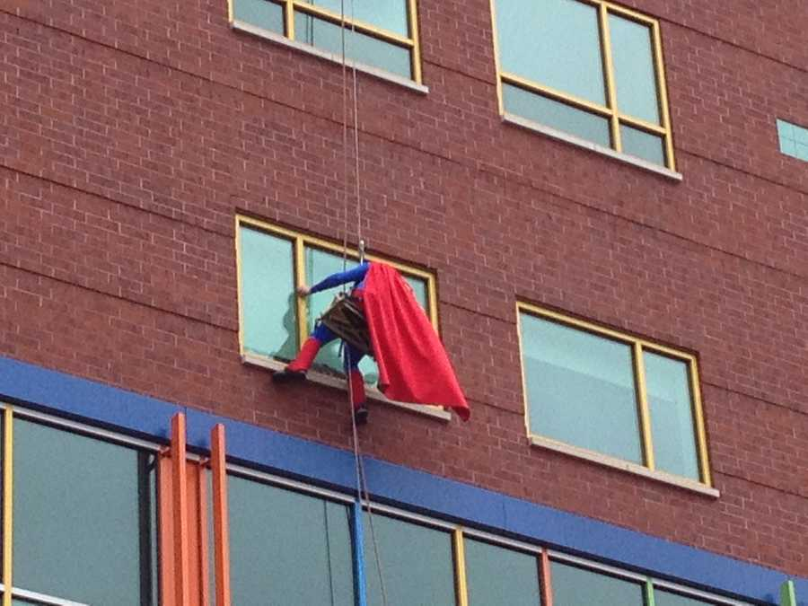 Superman washes windows at Children's Hospital of Pittsburgh.