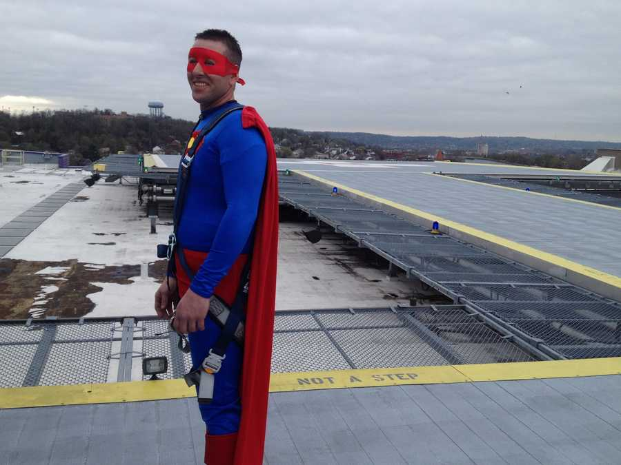 """""""To put a smile on these kids' faces for even a minute makes the whole day go good,"""" said Edward """"Superman"""" Hetrick."""
