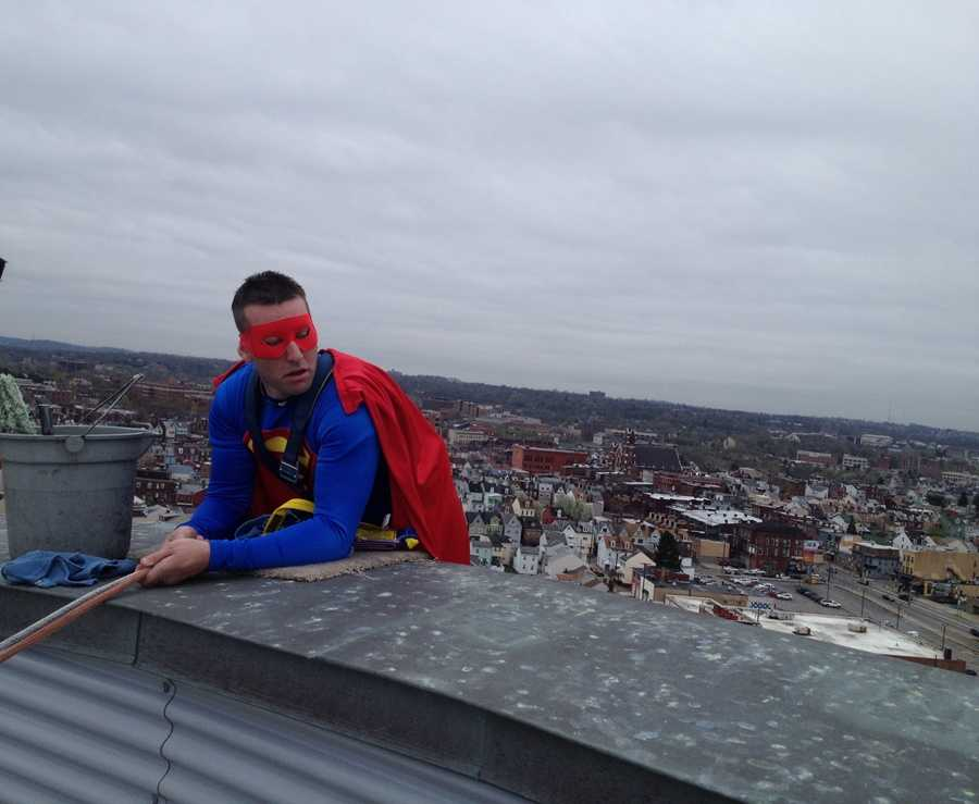 The costumed window-washers went over the edge of the hospital's roof ...