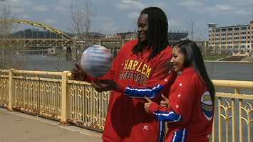 "Two members of the Harlem Globetrotters dribble across the Roberto Clemente Bridge and into Allegheny Elementary Academy, where they entertain 500 students while giving their ""ABCs of Bullying Prevention."""
