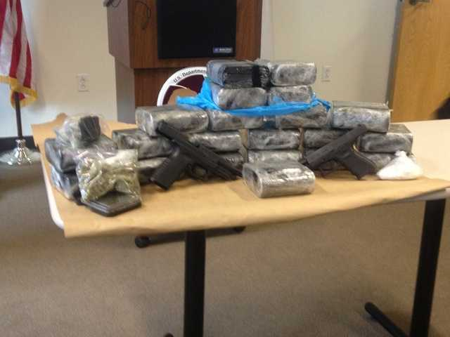 Cocaine with an estimated street value of $8.5 million, along with cash and guns that were seized.