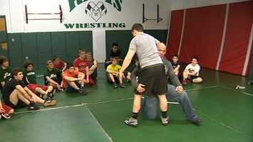 Kurt Angle got on the mat to give some instruction to Pine-Richland High School wrestlers.
