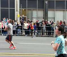 James Kirwa (in red) right before he crosses the finish line to win the Pittsburgh Marathon