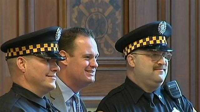 Mayor Luke Ravenstahl poses for a picture with two Pittsburgh police officers