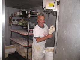"""Joel Hoffman says: """"I have been getting my pizza from Joe since he opened Aiello's in 1978, and before that when he was still at Mineo's. When he opened his own place, I chose my loyalty to him, and only would go there. After moving to Florida, his was the first stop I made when coming home to visit family. I would walk down to the store even before it opened to visit him in the back as he prepared dough. I always took my camera, and would take a picture or two for the memory. My brother told me of his situation weeks ago after stopping by the store and talking to his son Mike. He called to tell me immediately, and I talked to Mike a couple days later. I told him to let his dad know he was in my thoughts and prayers. Thank you for the moving tribute to a Pittsburgh legend. I will miss him dearly."""