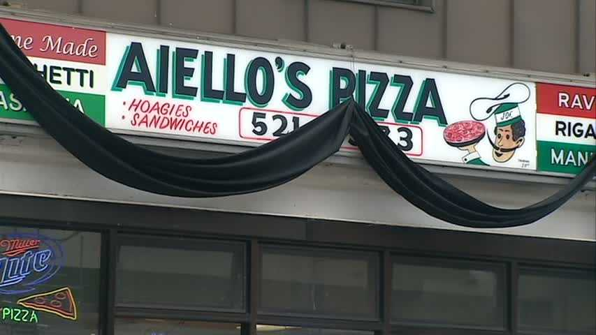 "A black shroud hangs over the sign of Aiello's Pizza on Murray Avenue in Squirrel Hill after the death of founder Giuseppe ""Joe"" Aiello."
