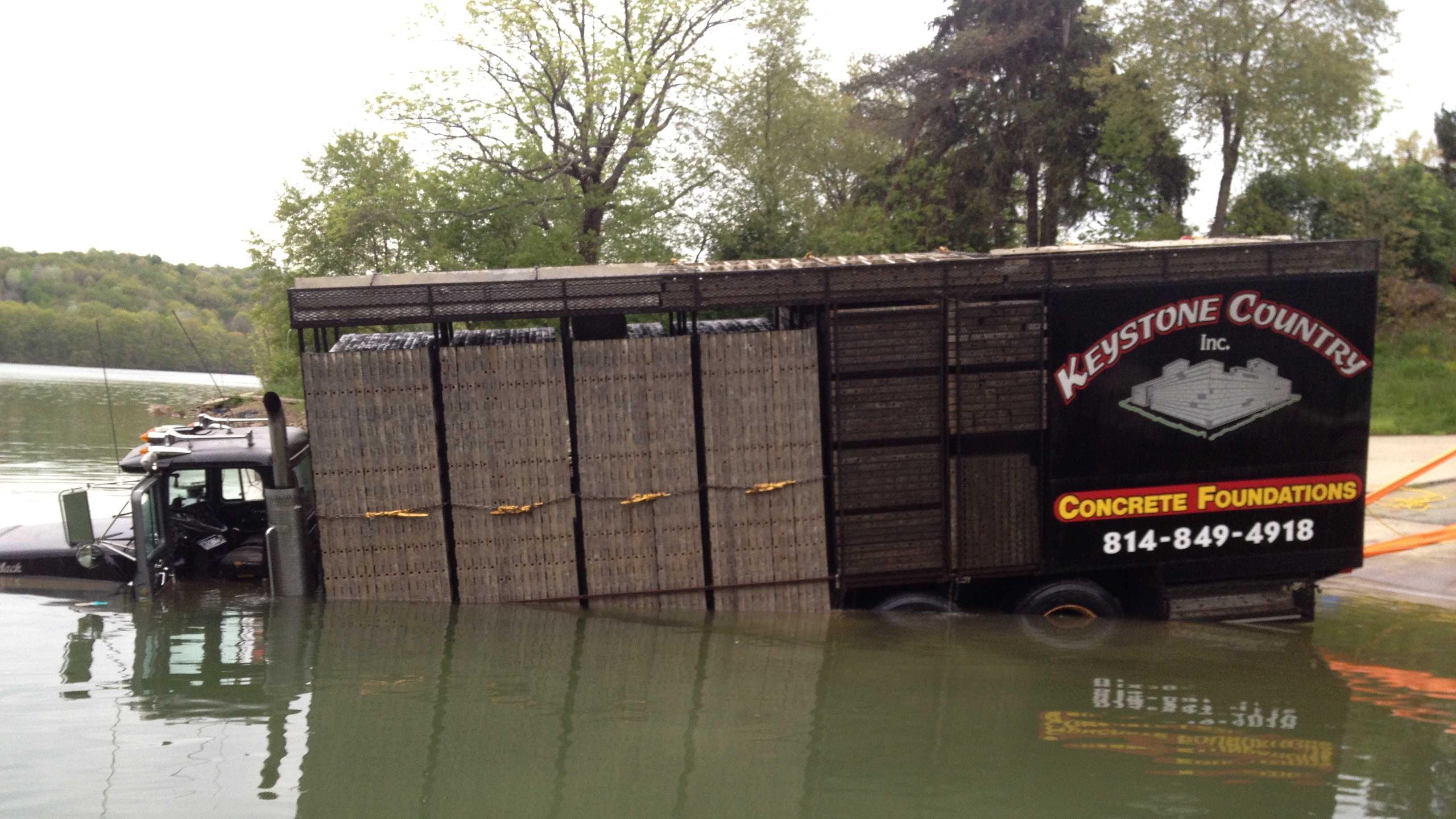 truck into Keystone Lake 7