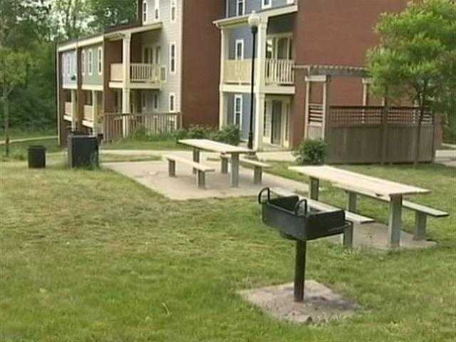 Picnic tables in the grass along East Hills Drive