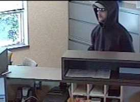 The FBI says the armed robber left the bank in a late-model, dark-colored sedan, possibly a Dodge.