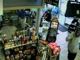 Police say the person in the light-colored hooded sweatshirt used one of the credit cards to buy gas and then tried to buy coffee.