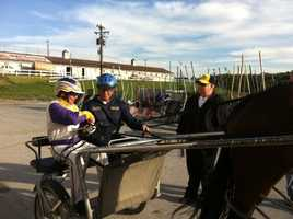 """Andrew Del Greco getting into his sulky. He named his horse """"Newshound."""""""