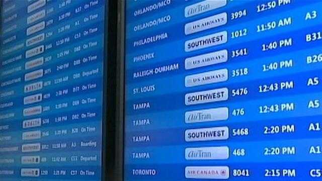 flight board at Pittsburgh International Aiport