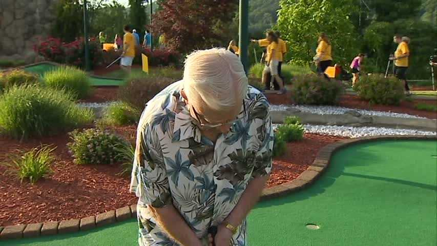 Joe hits the links for a round of minigolf.