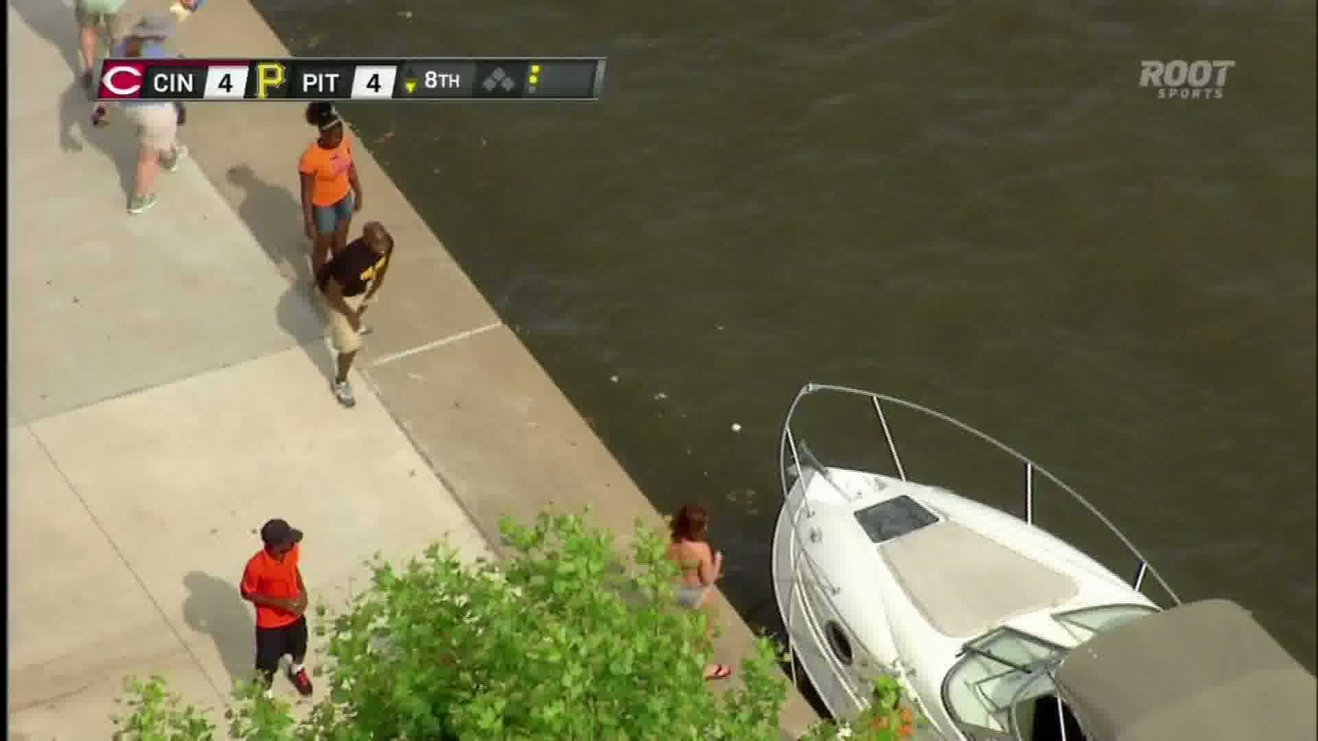 Fans watch the baseball splash into the Allegheny River after a home run by Garrett Jones.